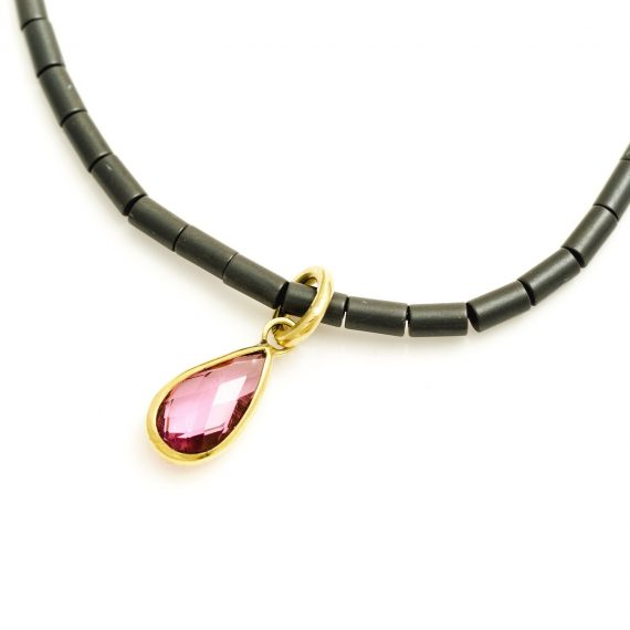 Pink Tourmaline on haematite