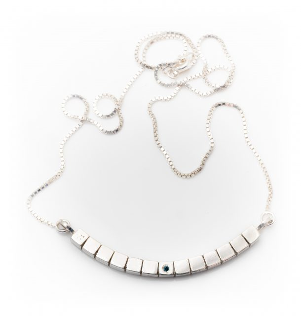silver short curved cube necklace with blue diamond