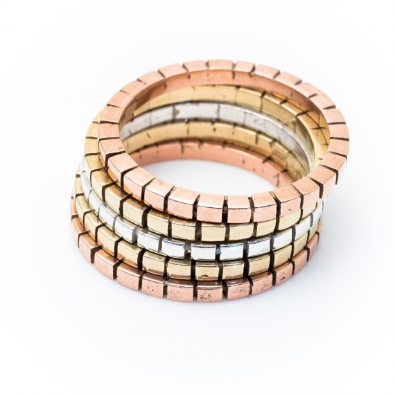 three coloured gold and silver cube rings