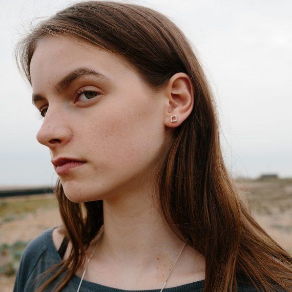 Silver open square stud earring modelled