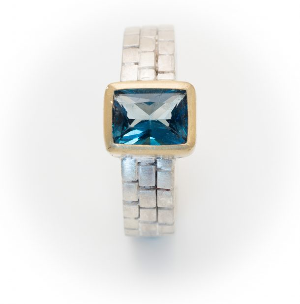 silver and gold cube ring with Topaz