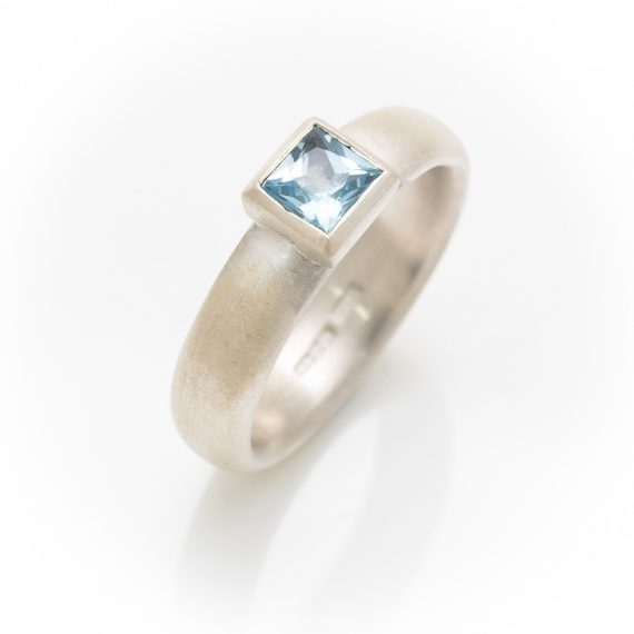 silver matt ring with square Topaz