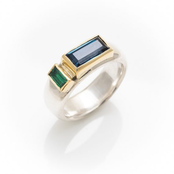 Wide silver ring with rectangular topaz and tsavorite garnet