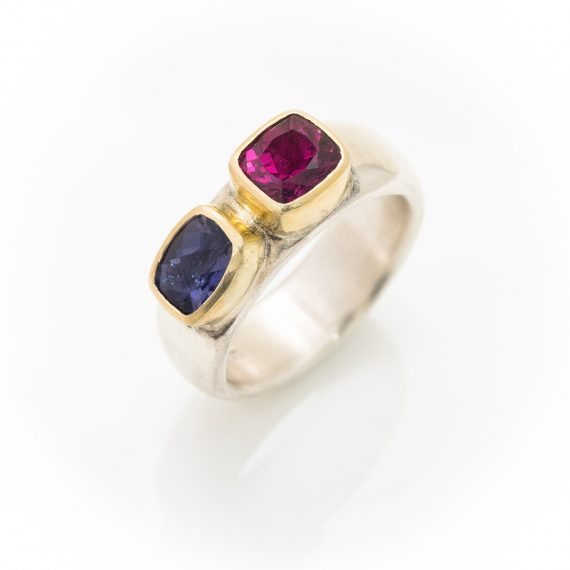 Wide silver ring with Iolite and Garnet set in 18ct gold