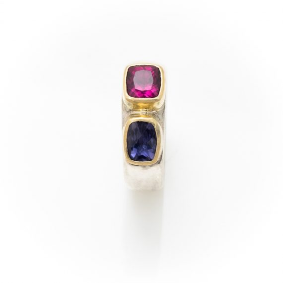 Wide silver ring with Iolite and Garnet with 18ct gold settings