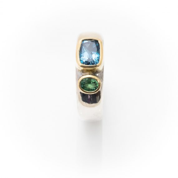 Wide silver ring with Topaz and Tsavorite garnet set in 18ct yellow gold