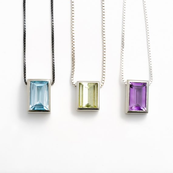 rectangular stone pendant with topaz beryl and amethyst