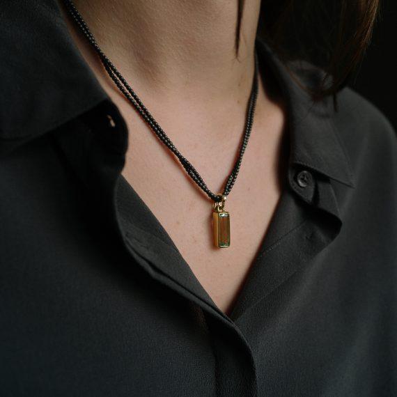 18ct gold beryl pendant on haematite beads
