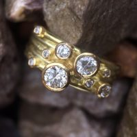 18ct gold ring with scattered diamonds