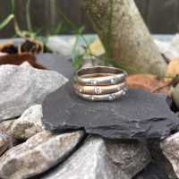 wave stacking rings with diamonds