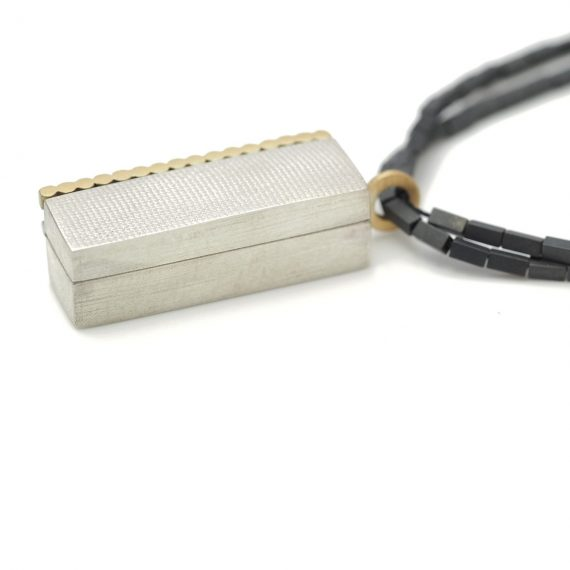 silver long box with 18ct gold