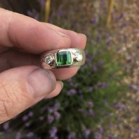 Tourmaline and diamond ring on silver band