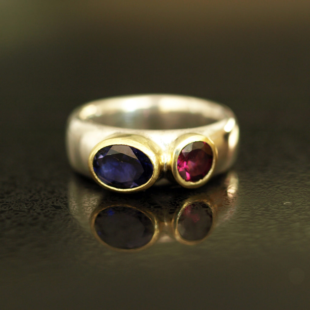 Iolite and garnet wide silver ring