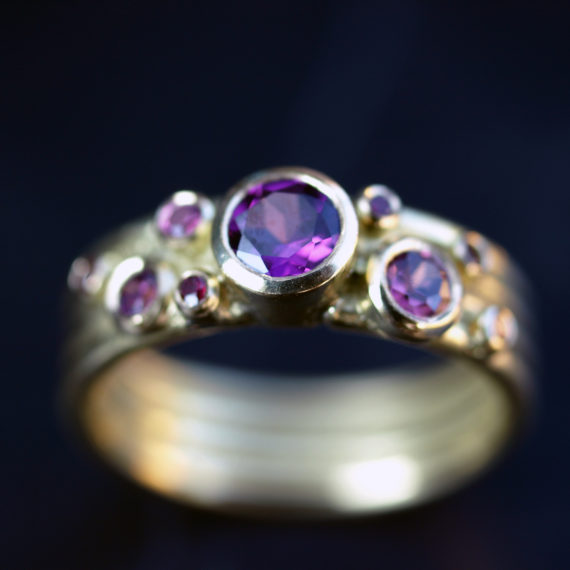 18ct gold ring with Rhodelite garnets and rubies