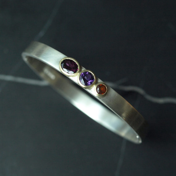 chunky silver bangle with garnet, amethyst and citrine