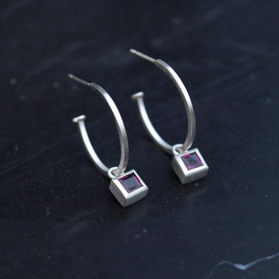 silver hoop earring with square rhodolite garnet