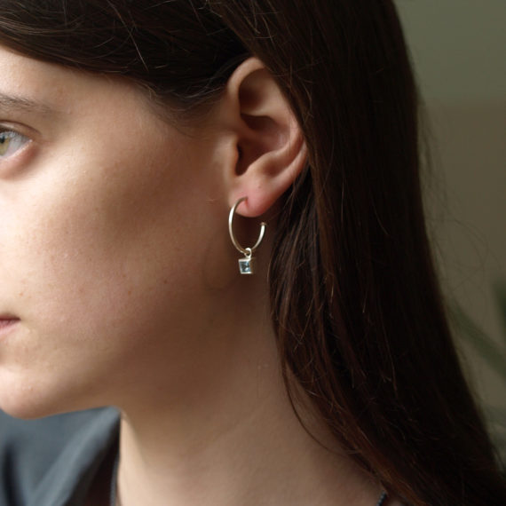 silver hoops with square topaz drops