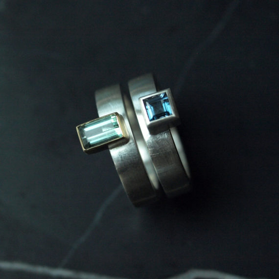 Geometric silver stacking rings with topaz and tourmaline
