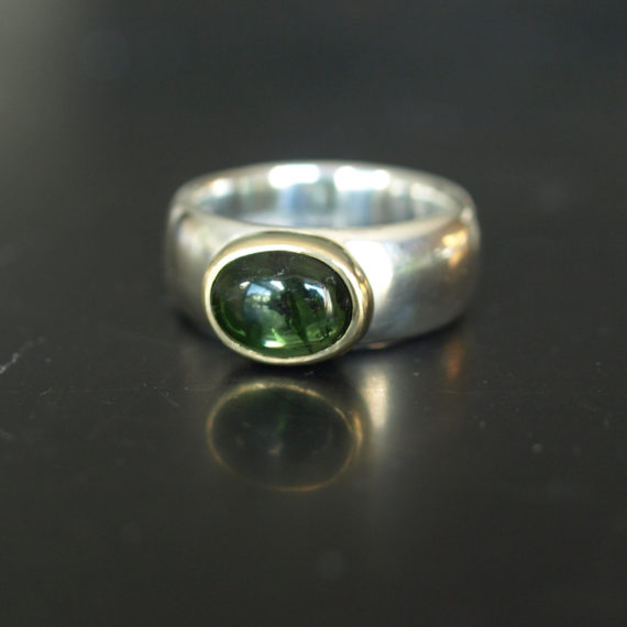 chunky silver and gold ring with green cabuchon tourmaline