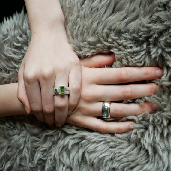 geometric stacking rings with peridot and topaz